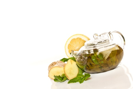 green tea with mint and ginger on a white background photo