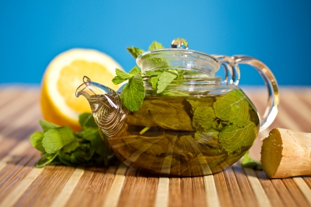 green tea with fresh mint on a blue background photo