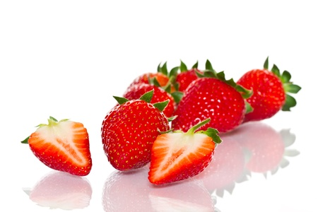 ripe red strawberries on a white background photo
