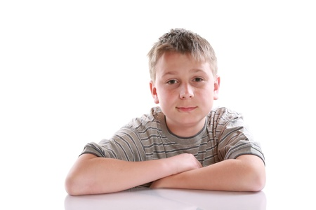 portrait of a pensive teenager on a white background photo