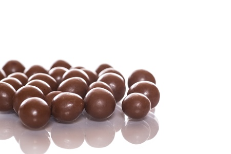dragees: chocolate candy balls on a white background Stock Photo