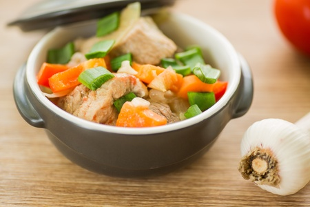 pork stew with vegetables in a pot photo