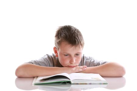 boy reading a book on a white background photo