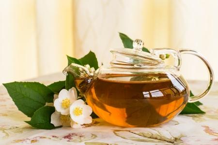 fragrant jasmine tea in the teapot on the table photo