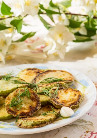 quick snack: fried zucchini with garlic closeup on a plate