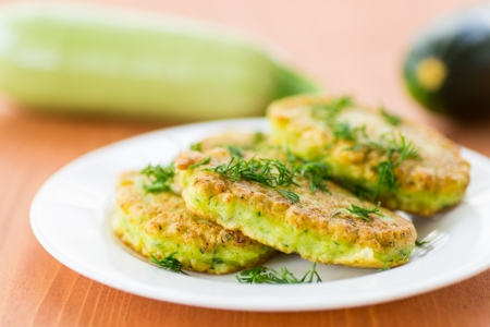 fried zucchini fritters with dill on a plate 写真素材