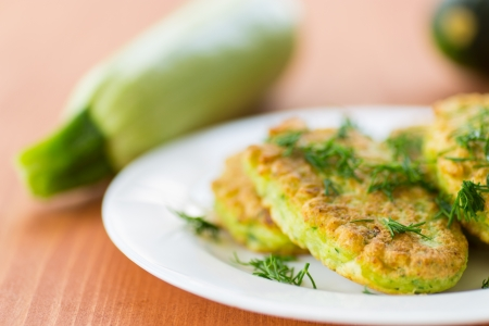 fritter: fried zucchini fritters with dill on a plate Stock Photo