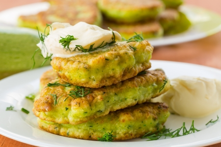 fritters: fried zucchini fritters with dill on a plate Stock Photo