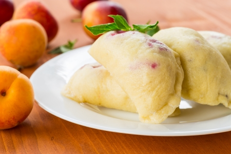 dumplings with sweet fruit on a white plate photo