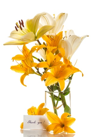 glass vase: beautiful yellow lilies on a white background