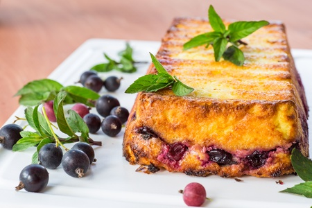 Cottage cheese pie with berries decorated with mint Stock Photo - 20870296