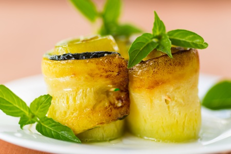 zucchini rolls stuffed with basil on a plate photo