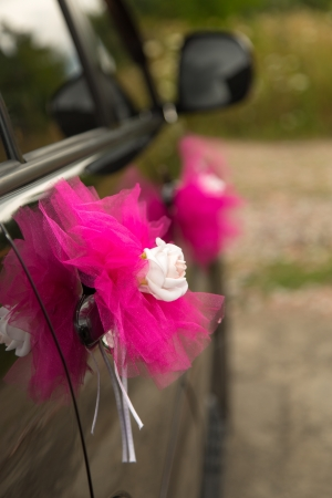 wedding car decorated with flowers and ribbons photo