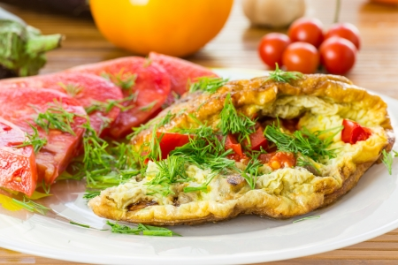 omelet with vegetables and tomatoes on a plate photo