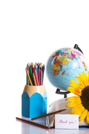 globe with pencils and a sunflower on a white background Stock Photo - 21359304
