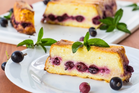 Cottage cheese pie with berries decorated with mint photo
