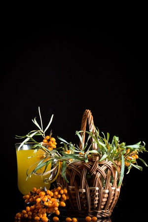 sea buckthorn tea in a cup on a black background Stock Photo - 21607967