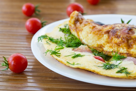 scrambled eggs with tomatoes and sausage with fennel photo