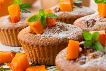sweet pumpkin muffins with walnuts and powdered sugar