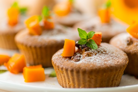 sweet pumpkin muffins with walnuts and powdered sugar Stock Photo - 21957982