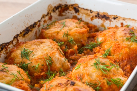steamed chicken meatballs in tomato sauce with dill photo
