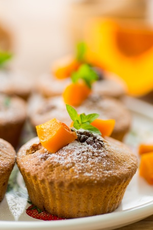 sweet pumpkin muffins with walnuts and powdered sugar Stock Photo - 22009267