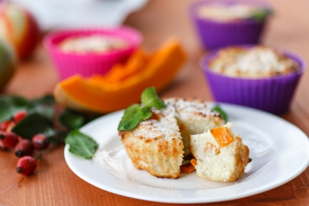 cheese muffins with pieces of pumpkin inside photo
