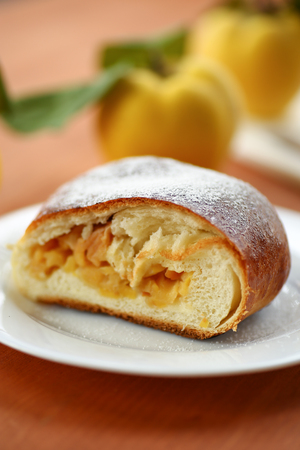 sweet strudel stuffed with quince on the table Stock Photo - 22643294