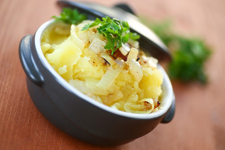 mashed potatoes seasoned with fried onions and parsley