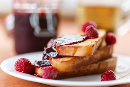 French toast with raspberry jam on a plate Stock Photo