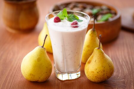 pear smoothie with berries and mint in a glass photo