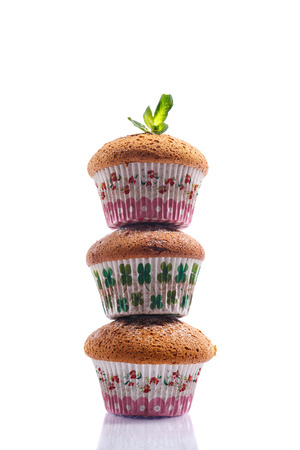 cupcakes isolated: honey muffins with powdered sugar and mint