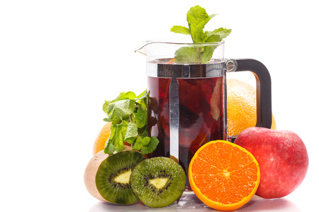 fruit tea with exotic fruit and mint on a white background photo
