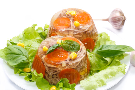 jellied meat with carrots garnished with vegetables