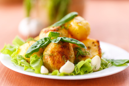 potatoes baked with garlic and dill on a plate