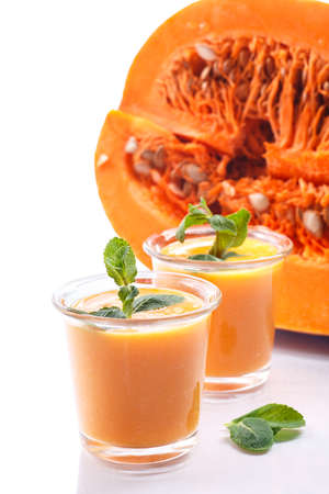 sweet pumpkin smoothies with chunks of pumpkin and mint photo