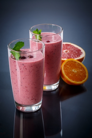 sweet fruit smoothie on a dark background Standard-Bild