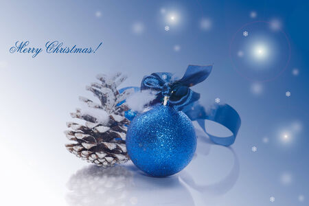Christmas card with blue ball and fir cones photo