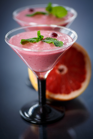 sweet fruit smoothie on a dark background photo