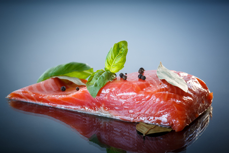 red fish: salted red fish with greens on a dark background Stock Photo