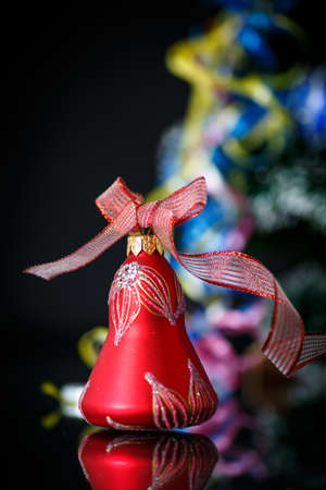 Christmas bell with red ribbon on black  photo