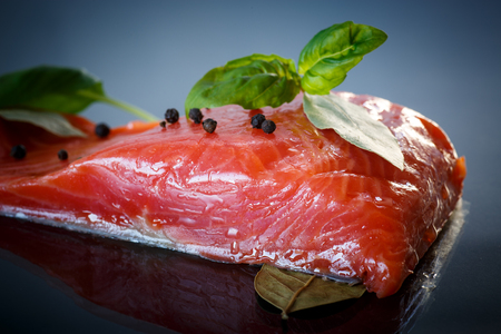red fish: salted red fish with greens on a dark