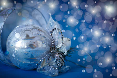 Christmas card with balls and ornaments on a blue background photo