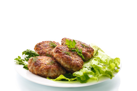 fried meatballs with herbs on white background photo
