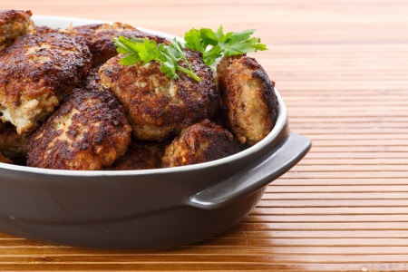 fried meatballs with herbs on the table 写真素材