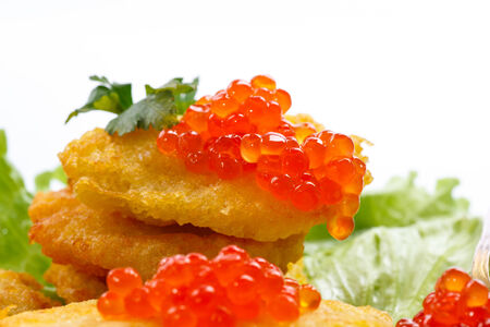 potato pancakes with red caviar on a white background photo