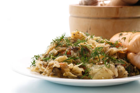 braised mushrooms: braised cabbage with mushrooms on a white background Stock Photo
