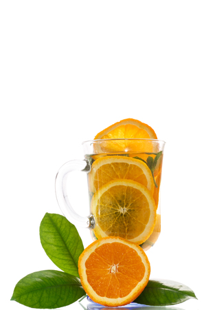 fruit tea with oranges and mint on a white background photo