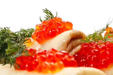 pancakes with red caviar on a white background photo