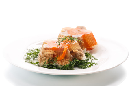 jellied meat with dill on a plate photo